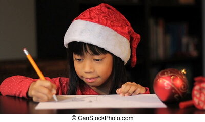 Drawing Picture For Santa Claus - A cute six year old Asian...