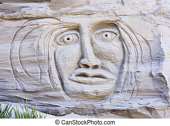Face In A Sand Cliff - A primeval face appears in the cliffs...