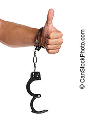 Hand with handcuffs - Man hand with handcuffs isolated on...