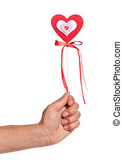 Hand with heart on a stick