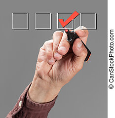 mark the check boxes - hand with pen mark the check boxes