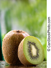 Organic Kiwi fruit - Organic kiwi fruit on a stone counter
