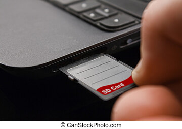 Plugging in SDxc memory Card - Plugging in SD Card into...