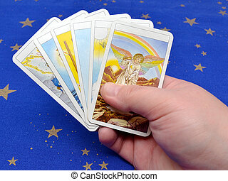 Tarot Cards - Fortune-teller holding tarot cards in hand on...