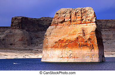 Lone rock in the middle of lake powell