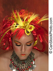 Fire - Girl with red, orange, yellow hair and beautiful make...