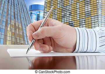 Male Hand with Pen - Businessmans Hand with Pen on the...