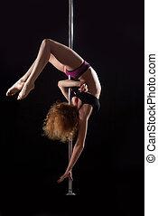 Sexy pole dance woman in  bikini