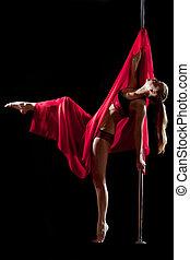 Pole dance woman in red bikini with fabric