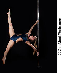 Strong pole dance woman in costume