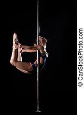 Pretty pole dance woman in costume