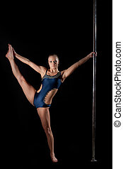 Young pole dance woman in costume