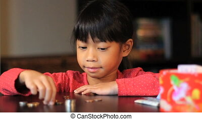 Six Year Old Girl Counting Money - A cute little six year...