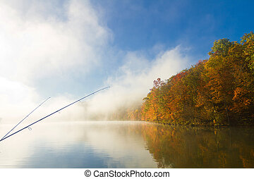 fishing poles, misty morning on Missouri lake