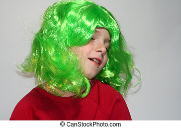 Dreamy Boy in Green Wig - Young boy wearing a bright green...