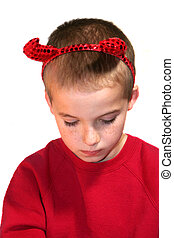 Little Devil Boy With Bowed Head - Young boy with his head...