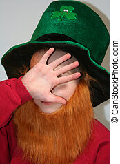 Shy Leprechaun Boy - Shy young boy wearing leprechauns green...