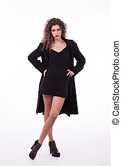 young and beautiful woman, with curly hair, with a winter coat, on white background, studio shot