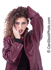beautiful woman, with curly hair holding her hair, with with his tongue out and a winter coat, isolated on white background, studio shot