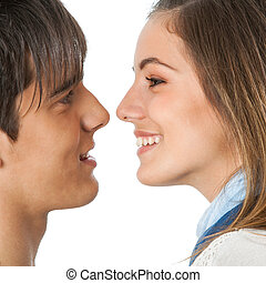 Cute couple about to kiss. - Close up portrait of teen...