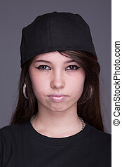 Happy and beautiful young woman, with a hood, studio shot
