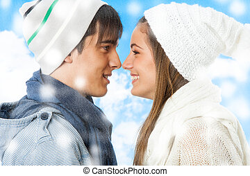 Cute young winter couple. - Close up portrait of cute young...