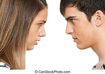 Teen couple with cross face expression. - Close up portrait...