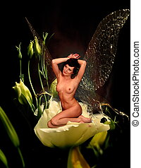 Nude fairy - Girl with transparent wings sits on a flower