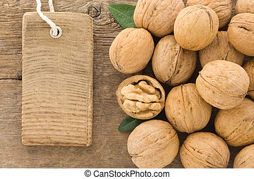 walnut and tag price label on wood background