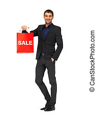 handsome man in suit with shopping bags - picture of...