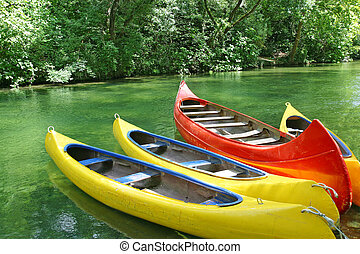 Four plastic canoes - Four empty plastic canoes in turquoise...