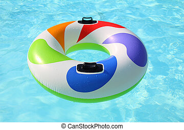 colorful swim ring floating on a blue swimming pool