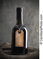 Red wine bottle with old paper label, copy space on label