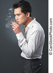 Exhaling smoke - Smoking businessman exhales his smoke from...