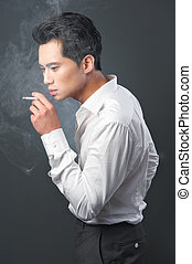 Smoking Kills - Businessman smoking his cigarette and is...