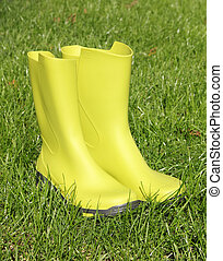 Green gumboots on greeen grass