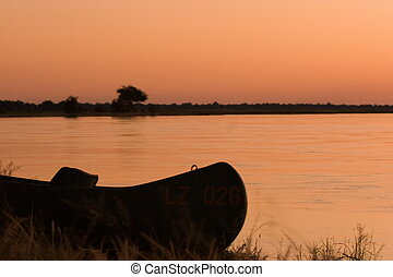 Canoe on Zambezi Riverbank in Zambia