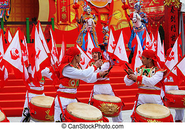 Red and gold drums and lots of red flags - Chinese New Year....