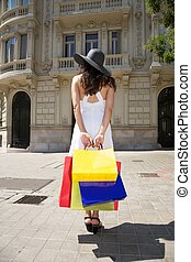 white dressed woman holding shopping bags - brunette woman...