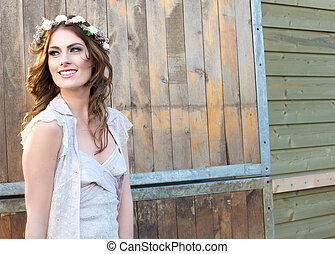 Bohemian Bride - Beautiful young bride with flowers in her...