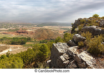 rich agricultural valley bathed in a small river in the region of Aragon, Spain