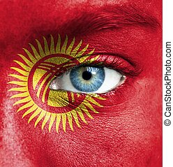 Human face painted with flag of Kyrgyzstan