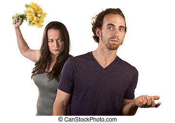 Angry Woman with Flowers and Naive Man - Woman ready to...