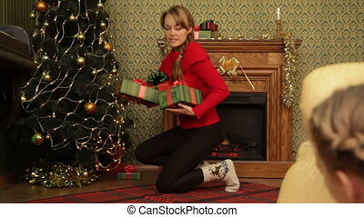 Christmas mystery - Mother hiding gifts under a Christmas...