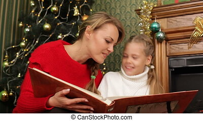 Reading a story - Mother reading a story to her daughter...