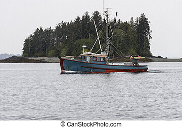 Blue Shrimp Boat Past Green Island - A blue shrimp boat...