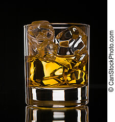 Whiskey on black - Glass of whiskey on the rocks on black...