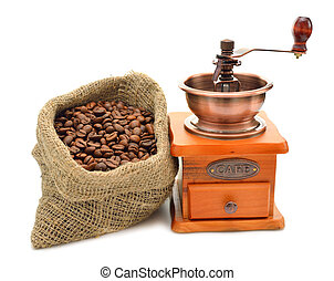 Coffee beans and hand grinder