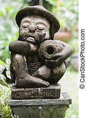 The statue of oldman holding the ja - The statue of old man...