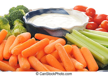 Vegetable tray with ranch dressing - A vegetable tray with...